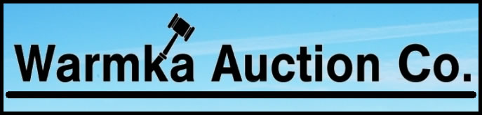 logo Warmka Auction Co. Racine MN